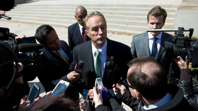 Rep. Chris Collins, R-N.Y., speaks with reporters as he leaves a closed-door meeting with Donald Trump on March 21, 2016, in Washington.