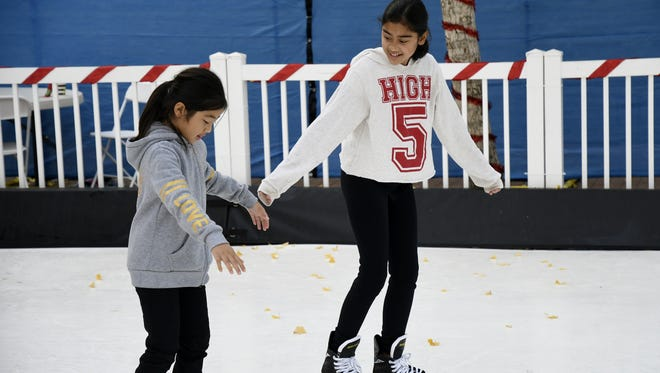 Neveah See, 11, teaches sister Kaori See-Saelee, 8, how to skate at Ice Skate Visalia in December 2017.