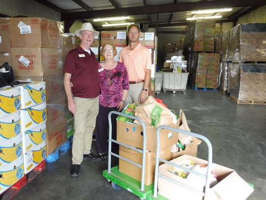 Volunteers with the Concho Valley Regional Food Bank helps provide grocery items to organizations and churches that feed the community's hungry residents.