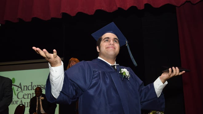 Chris T. expresses his excitement after receiving his diploma during Friday's commencement ceremony at the Anderson Center for Autism in Stattsburg.