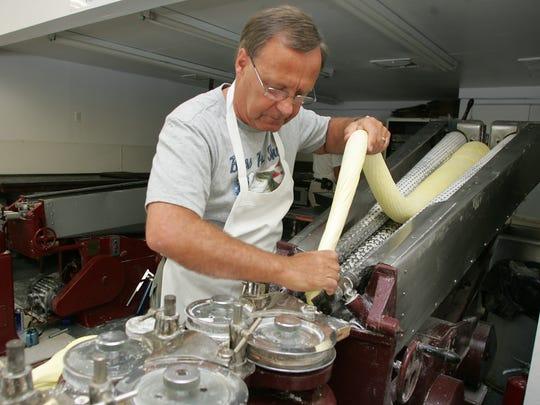 Berkeley Sweet Shop owner Bernt Hage makes salt water taffy in a 2009 file photo.