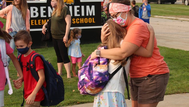 A parent says goodbye to their student on the first day of school at Bentheim Elementary Wednesday, Aug. 26.