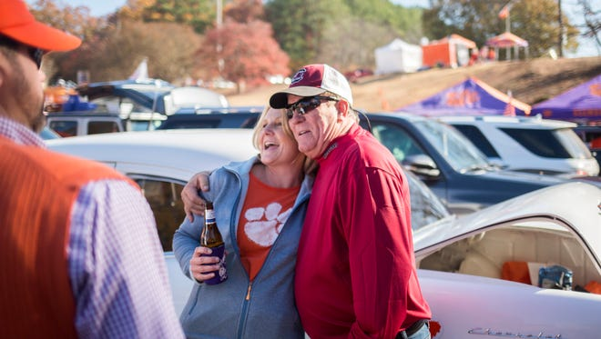 USC fan Michael June hugs family friend and Clemson fan, Jackie Browning at the Clemson vs. USC tailgate on Saturday, November 26, 2016 at Clemson.