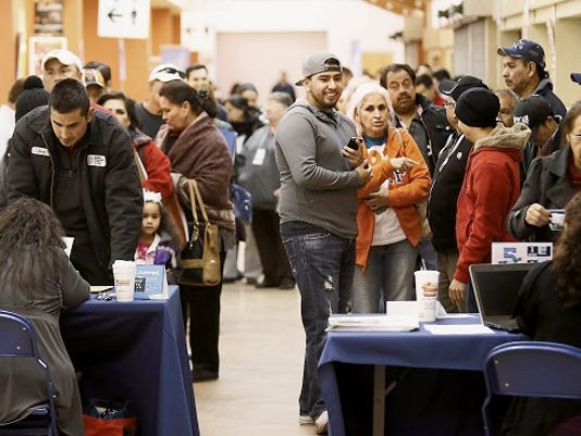 El Pasoans flocked to the El Paso County Coliseum to enroll in Obamacare on Feb. 12.