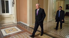 Senate Majority Leader Mitch McConnell walks to his