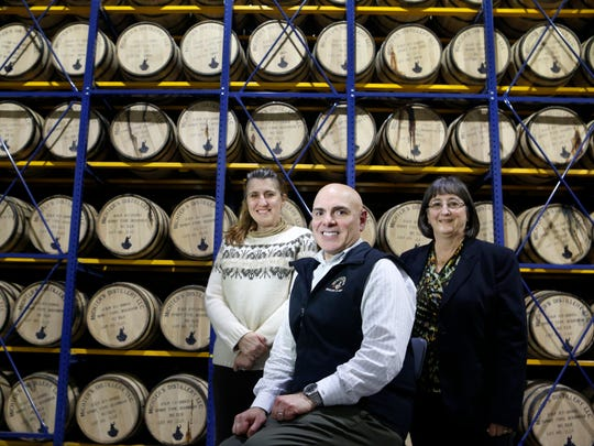Joseph Magliocco, center, President of Michter's Distillery