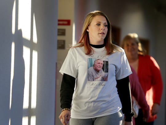 Brittany Jordan wears a shirt with the picture of her grandfather, Floyd Zumwalt, as she walks to Kitsap Superior Court on Tuesday morning. Several family members wore the shirts to the sentencing hearing Tuesday.