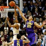 LSU's Ben Simmons (25) goes up to block the shot of College of Charleston's Cameron Johnson during first half action of Monday's game.