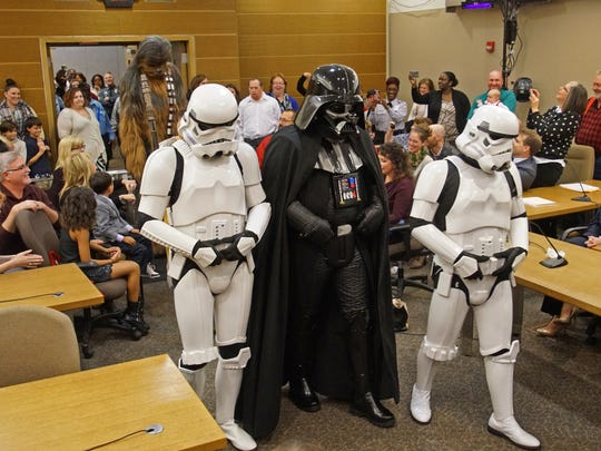 A cast of Star War impersonators enter the family courtroom during the official adoption to 4-year-old daughter Zoe to Deanna Pedicone on Friday.