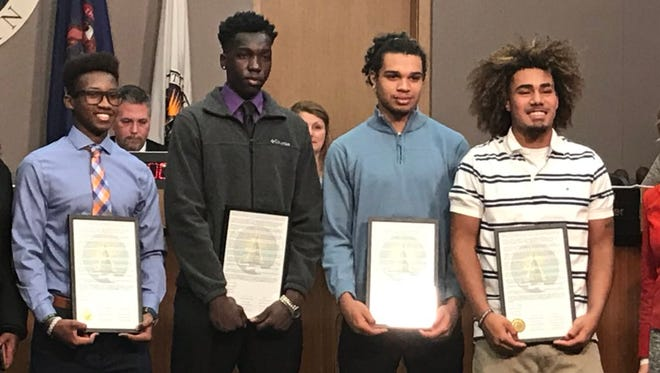 Lansing City Council honored four high school students with a resolution on Monday, December 11, 2017. The students were punished by Lansing Catholic High School after kneeling during the national anthem to protest racial injustice.