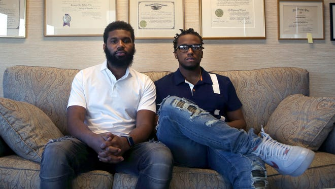 Rashon Nelson, left, and Donte Robinson, both 23,  settled with the city of Philadelphia for a symbolic $1 each and a promise from city officials to set up a $200,000 program for young entrepreneurs.