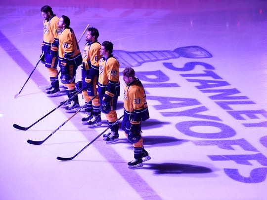 The Predators stand at attention during the National