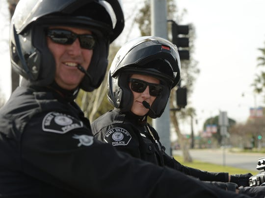 Officers Eric Bowman, left, and Jessica Neumann pose for a photo. Neumann is the first female motorcycle officer with the Simi Valley Police Department.