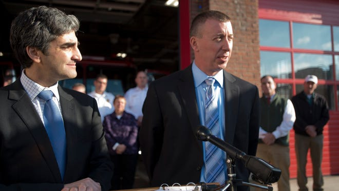 From left, Burlington Mayor Miro Weinberger announces Steven Locke, the chief of the Hartford Fire Department, as his pick to head the Burlington Fire Department during a news conference Thursday.