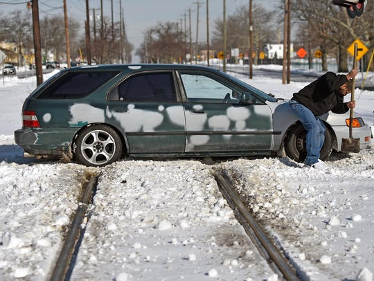 Alfredo Nieves of Vineland tries to dig his car free