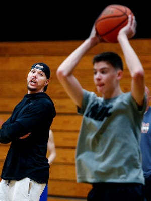 Former NBA player Mike Miller looks on as his son, Mason (right), practices with M33M's 16-and-under team. Miller has recently field interest from Memphis, Florida, TCU and Louisville about becoming a college assistant coach next season.
