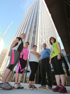 The Paso del Norte Health Foundation team for the upcoming Workplace Race includes, left to right, Rikki Holcomb, Nohemi Rubio, Bianca Aguilar, Jon Law and Jana Renner. They are shown outside the building Downtown, which houses their offices.