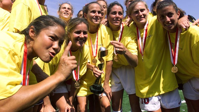 Members of the US soccer team pose with their medals after beating China to win the 1999 Women's World Cup.