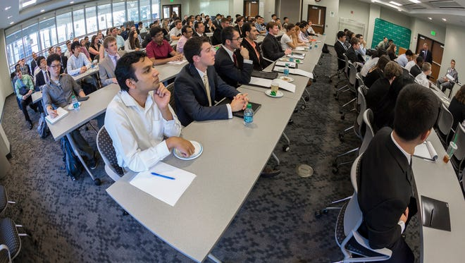 Engineering students at the Watson School of Engineering and Applied Sciences attending an Employer Career Secrets Panel and networking event  at the Engineering and Science Building at the Innovative Technologies Complex in September 2015.