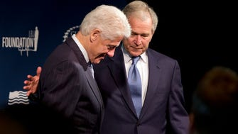 Former presidents Bill Clinton, left, and George W. Bush are joining together to train a new generation of leaders.