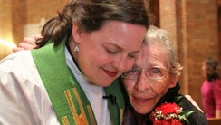 The Rev. Lisa Bates-Froiland hugs Bessie Bray, 100,