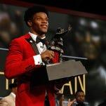Louisville QB captures Heisman Trophy