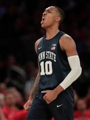 Penn State guard Tony Carr reacts after hitting a 3-point shot against Utah during the second quarter of an NCAA college basketball game for the NIT championship Thursday, March 29, 2018, in New York. (AP Photo/Julie Jacobson)