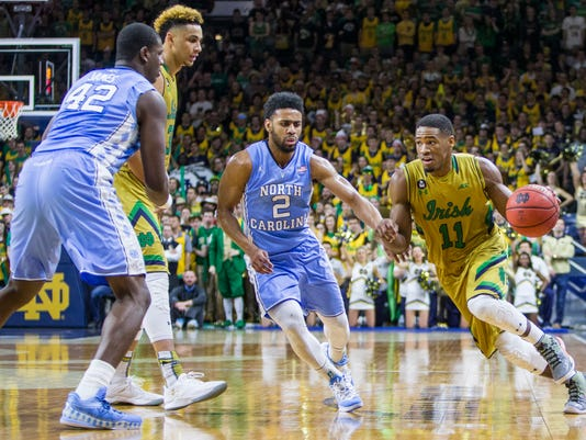 Notre Dame's Demetrius Jackson (11) drives by North Carolina's Joel Berry II (2) during the second half of Notre Dame's 80-76 win in an NCAA college basketball game Saturday, Feb. 6, 2016, in South Bend, Ind. (AP Photo/Robert Franklin)
