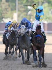 Victor Espinoza, aboard Amercian Pharaoh, celebrates after winning the Kentucky Derby.May 2, 2015