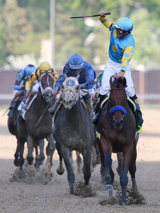 635661907300477753-american-pharoah-wins-kentucky-derby-2015