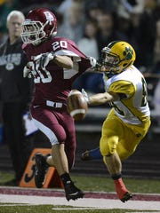 Ashwaubenon receiver Nathan Holly (88) tries to make a catch past De Pere cornerback Connor Kupsh (20) during Friday night's football game in De Pere. Kupsh was called for pass interference on the play.