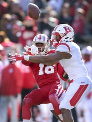 Hoosiers defensive back Rashard Fant (16) knocks the