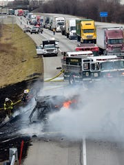 Firefighters extinguish a blaze that destroyed a camper being hauled by a truck on Interstate 81 at mile marker 13. The fire was reported just before 2:30pm on Wednesday, February 21, 2018.