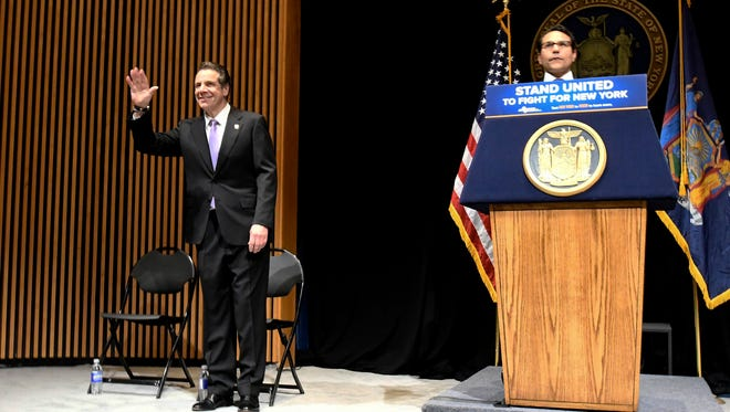 New York State Budget Director Robert Mujica introduces New York Gov. Andrew Cuomo ,left, during his 2018 executive state budget proposal during a news conference at the Clark Auditorium in Albany, N.Y., Tuesday, Jan. 16, 2018.