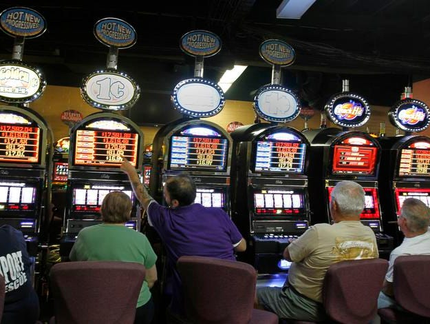 Patrons play video slot machines at Batavia Downs Casino in this 2010 file photo.