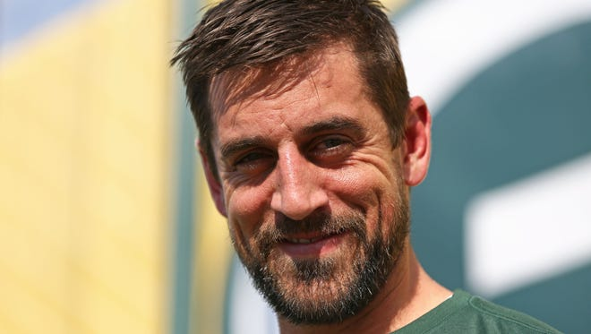 "During his early years in Green Bay, Packers quarterback Aaron Rodgers liked to sing karaoke at Mikey's Pub, he told ""The Doug Gottlieb Show"" on Thursday."