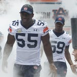 Auburn defensive linemen Carl Lawson and Raashed Kennion come out onto the field during the Auburn A-Day spring game. Lawson is on the Lombardi Award watch list.