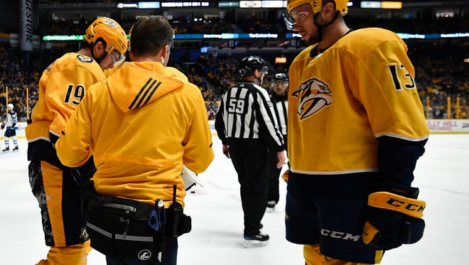 Predators center Calle Jarnkrok (19) is helped off the ice after being slammed into the boards during the third period Tuesday against the Jets.