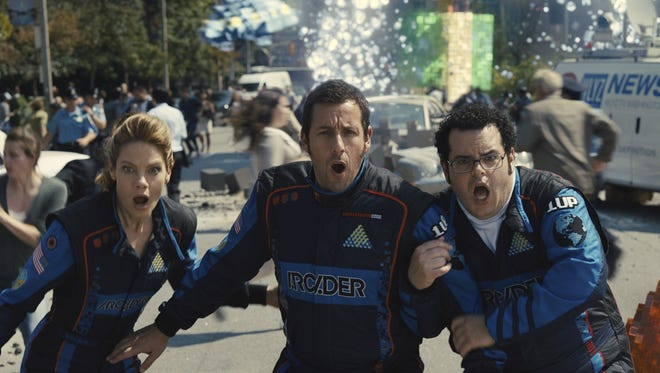 "The family-adventure, ""Pixels,"" starring Michelle Monaghan, from left, as Violet, Adam Sandler as Sam Brenner and Josh Gad as Ludlow, will be shown this week during Movies Under the Stars."