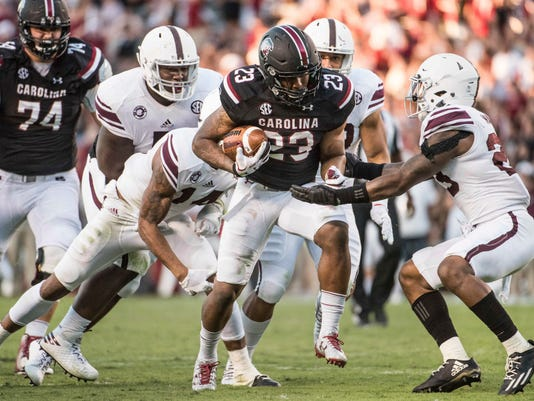 South Carolina running back Rico Dowdle runs the ball against the Texas A&M defense during the second half of an NCAA college football game, Saturday, Oct. 1, 2016, in Columbia, S.C. Texas A&M defeated South Carolina 24-13. (AP Photo/Sean Rayford)