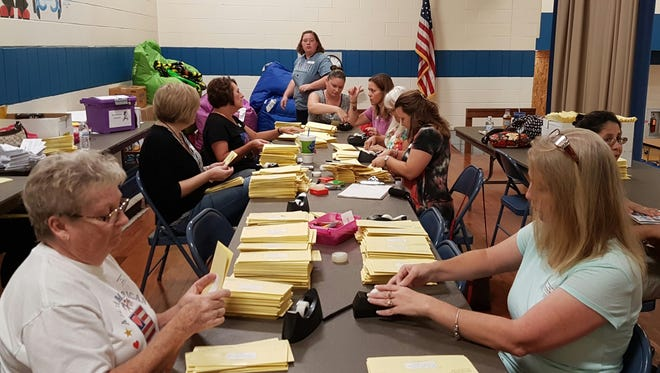 Parent volunteers stuffed more than 21,000 mailers in the hopes of raising money for primary and elementary students in October.