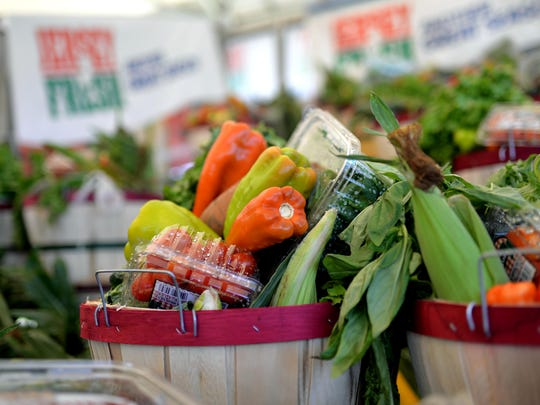 Baskets of produce for sale and up for auction are