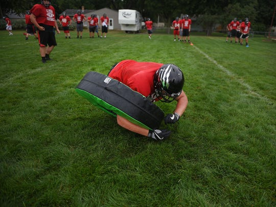 Brandon Valley High School left tackle Max Howard participates in a drill during practice Monday, Aug. 14, at the high school in Brandon.