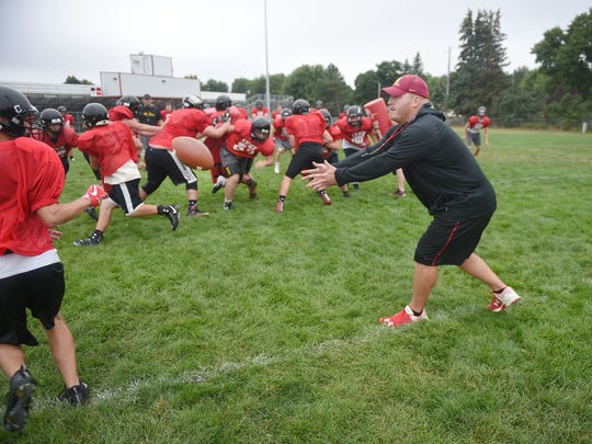 Brandon Valley High School offensive line coach Mike Zerr works with the offensive line during practice Monday, Aug. 14, at the high school in Brandon.