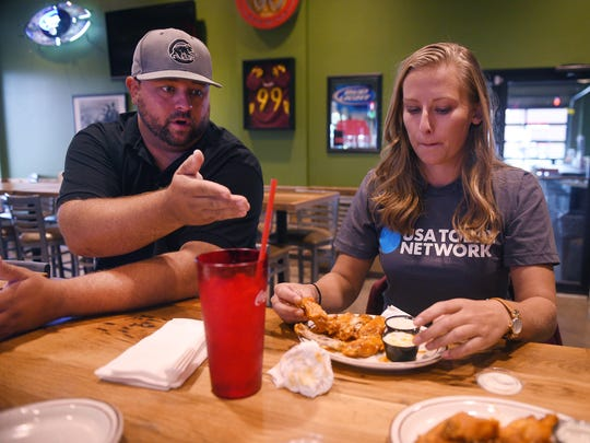 """""""This is supposed to be our busy season,"""" says Andy Rose (left), bar manager at Shenanigans on the west side of Sioux Falls."""