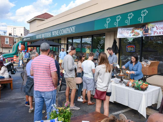 Revelers line up for food samples at Piccolina Toscana during Taste of Trolley Square last year. More than 30 area shops, restaurants and bars will participate this weekend.