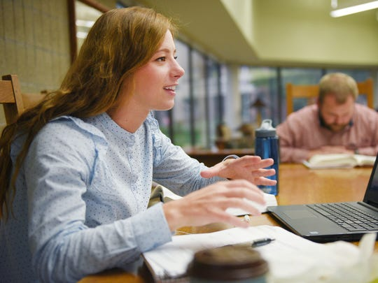 Elisa Glab, first year law student, talks about how she feels about the University of South Dakota's law school program possibly being moved to Sioux Falls, Monday, Oct. 2, in Vermillion. A USD Law School Task Force Friday will make recommendations about where to house the school in the future.