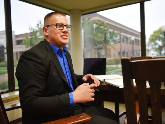 Kaleb Paulsen graduated from University of South Dakota's law school program this spring and passed the state bar exam. In this photo, he was discussing how he feels about the program possibly being moved to Sioux Falls, Monday, Oct. 2, 2017, in Vermillion.