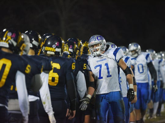 Bridgewater-Emery-Egan Bradlee Schultz shakes hands with Sioux Valley Friday, Nov. 3, in Volga after the game.