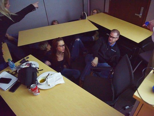 Howalt+McDowell Insurance employees hide under desk